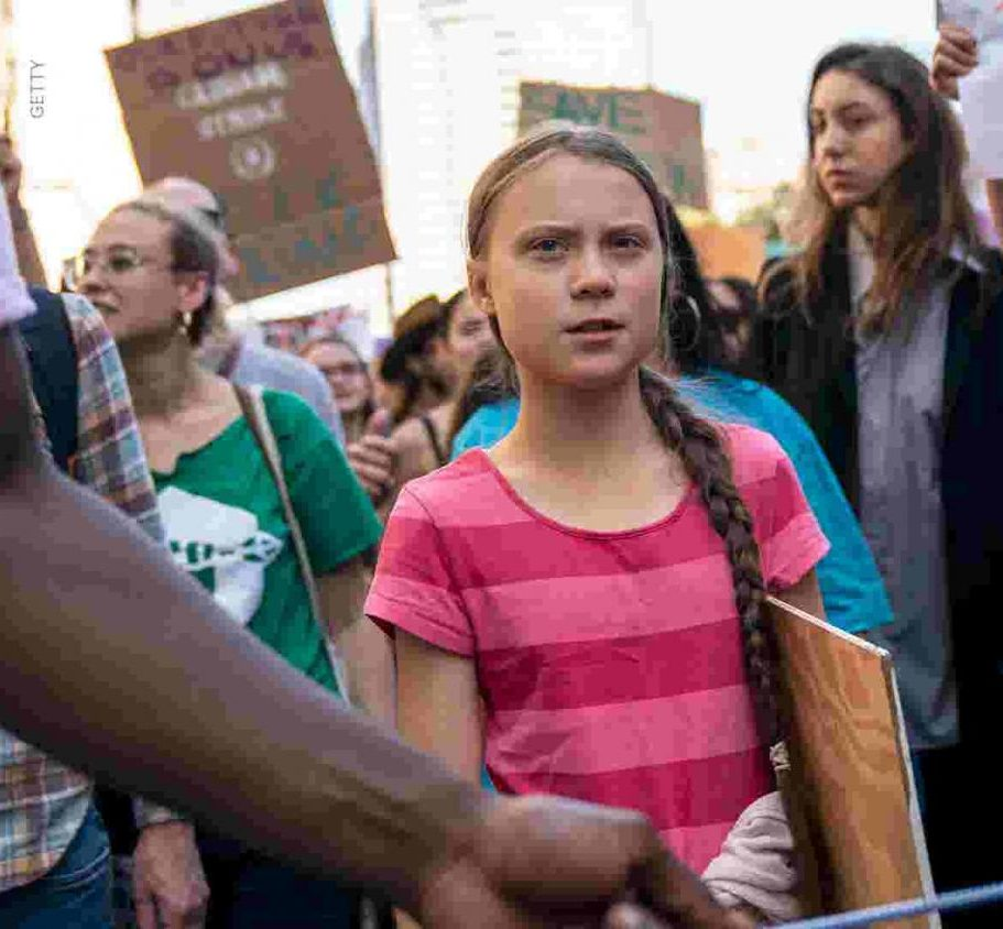 Greta Thunberg participates and leads a protest for climate change.