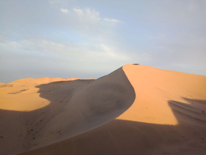 The Gobi Desert underlooking a pale blue sky in Inner Mongolia, China