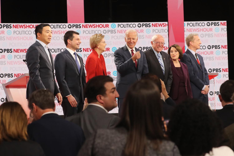 From left to right, the Democratic presidential contenders who participated in December's debate: Andrew Yang, Pete Buttigieg, Elizabeth Warren, Joe Biden, Bernie Sanders, Amy Klobuchar, and Tom Steyer. Photo credits to Jim Wilson/The New York Times.