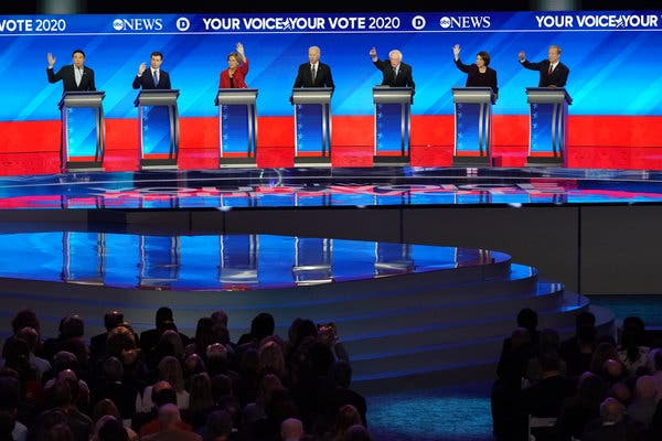 Following a muddled caucus in Iowa, seven Democratic primary candidates gathered in New Hampshire, the next state to vote, for a fractious debate which served only to highlight the volatility of the field. From left to right: Andrew Yang, Pete Buttigieg, Elizabeth Warren, Joe Biden, Bernie Sanders, Amy Klobuchar, and Tom Steyer. Photo credits: Chang W. Lee/The New York Times