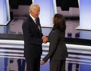 Presumptive Democratic nominee Joe Biden (left) shakes hands with California Senator Kamala Harris (right), his former primary rival and one of the leading contenders for the vice-presidential nomination, at the July 2019 debate. Biden has committed to choosing a woman as his running mate, and has repeatedly stressed his desire for a