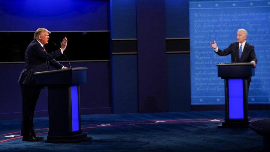 At the final presidential debate of the 2020 campaign, President Donald Trump (left) sparred energetically with former Vice President Joe Biden (right), though the introduction of a new mute button kept the crosstalk which had plagued the last debate to a minimum. In the final stretches of the campaign, Trump sought to rebrand himself, promising economic recovery and a swift end to the pandemic. Biden, on the other hand, made several progressive policy commitments in immigration and climate change, a departure from his generally risk-averse strategy. Photo credits: Brenden Smialowski / Getty Images.