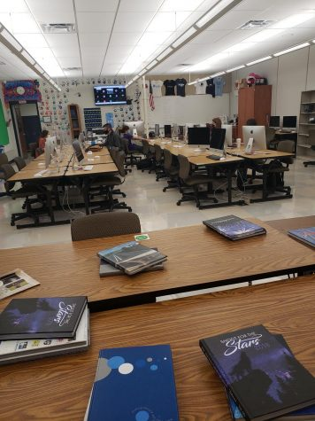 A classroom with five students has several empty desks. (October 23, 2020)
