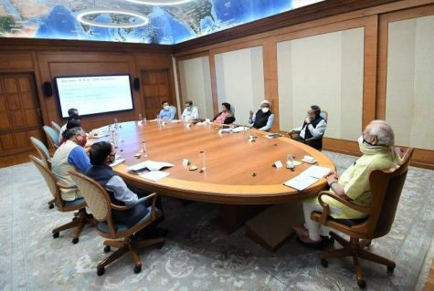 The PM from India meets to converse on a plan for vaccines and testing, being responsibly socially distanced and wearing masks to protect the other members of the meeting