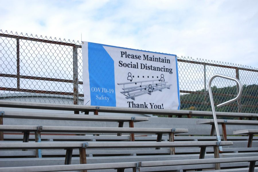 """Please Maintain Social Distancing"" sign posted at the top of WMC"