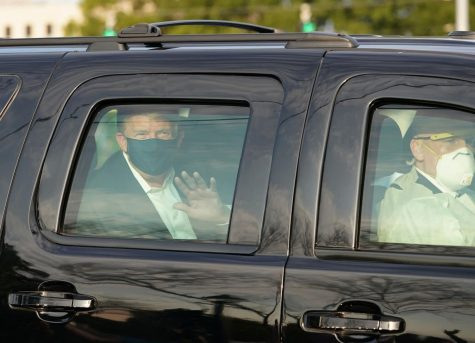 Trump waves at fans standing outside Walter Reed by CNN