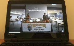 NHS advisors Mrs. Donlon and Mr. Cinotti introduce this year's Induction Ceremony, viewed on a school Chromebook.