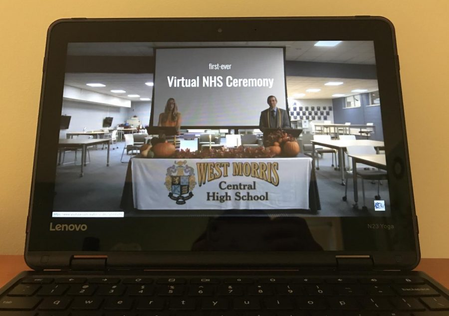 NHS+advisors+Mrs.+Donlon+and+Mr.+Cinotti+introduce+this+year%27s+Induction+Ceremony%2C+viewed+on+a+school+Chromebook.