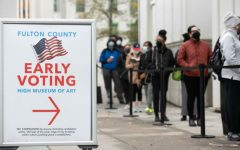 Voters line up for the first day of early voting outside of the High Museum polling station on December 14, 2020 in Atlanta, Georgia. Georgians are headed to the polls to vote in a run off election for two U.S. Senate seats.