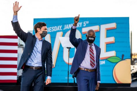 Jon Ossoff and the Rev. Raphael Warnock campaigning in Atlanta. Both defeated their Republican opponents, assuring that the balance of power in the Senate will shift.