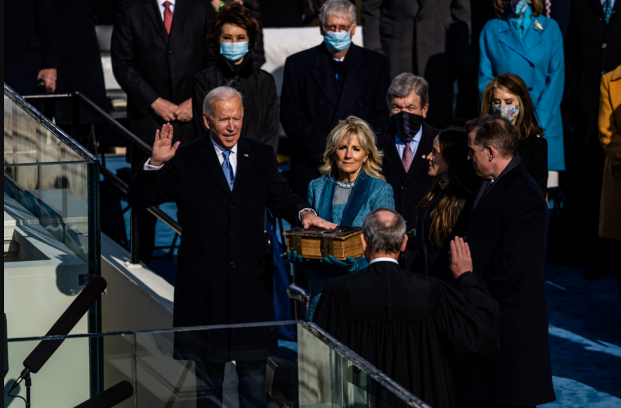 Joseph R. Biden (left), accompanied by his wife Jill Biden (center) is sworn in as the 46th President of the United States by Chief Justice John Roberts (right). In his inaugural address, Biden tirelessly stressed the need for unity in America, calling on the people of the nation to band together in the face of unprecedented challenges occurring simultaneously. Photo credits: Stephen Voss for Politico.