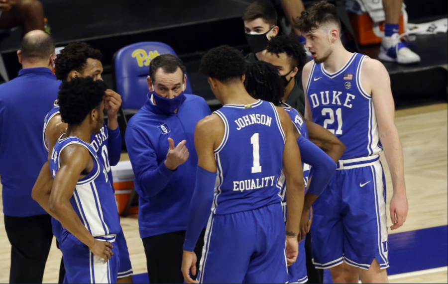 Duke Basketball starters huddle with coach K