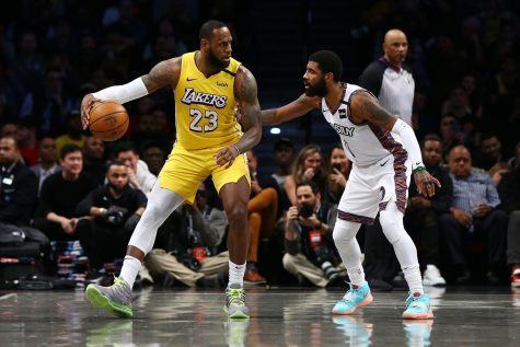 Lakers forward LeBron James posts up Brooklyn Nets point guard Kyrie  Irving.  (Mike Stobe / Getty Images)