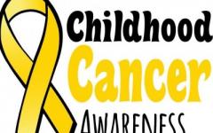 Gold Ribbon representing childhood cancer awareness. Photo credit: University of Iowa Dance Marathon