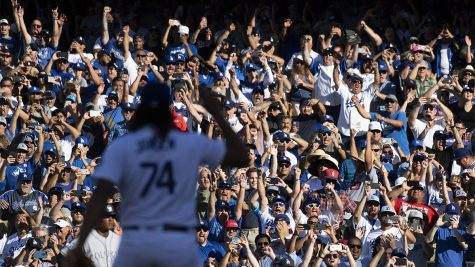 Baseball fans celebrate a win by their favorite team. (Photo by Kevin Sullivan/Digital First Media/Orange County Register via Getty Images)